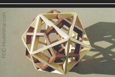 Dodecahedron & Icosahedron 'dual' model with wood stain in 2 colors Solid Geometry, Geometry Shape, Sacred Geometry, 3d Geometric Shapes, 3d Shapes, Physics Concepts, Platonic Solid, Geometric Sculpture, Mid Century Modern Decor