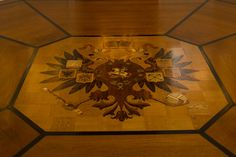 A double-headed eagle, part of the Russian imperial coat of arms, is inlaid into the floor of the Russian Porcelain Room.