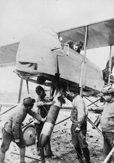 FIRST WORLD WAR 1914 - 1918 WAR AIR (Q 113742)   Ground staff manoeuvre a bomb into position in a Farman aircraft of the French Air Force on the Western Front, 11 November 1917.