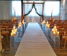 We like the candles down this aisle. The rest of the setting does not apply.