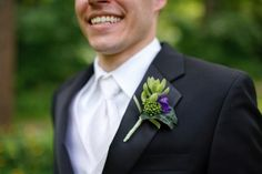 boutonniere with green succulent & touch of purple