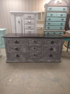 """I got funky with the painting style on this dresser. It would be perfect as a tv stand or baby changing table. What do you think? The dimensions are 66"""" L, 19"""" W, 31"""" H"""