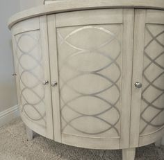 armoire? gripper primer, bone paint and metallic silver accents? maybe