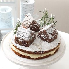 A little jam-filled village sits atop this moist gingerbread cake. Mascarpone cheese frosting is sandwiched in between the two layers to add a sweet, creamy touch and look like fresh snow.