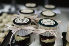 Wedding favors- we would do a cupcake in a jelly jar with a white topper and a purple ribbon with a sticker that says Lauren and Joe or something on the top