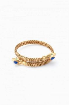 This vintage gold bracelet coils around your wrist for a striking look. Beautiful blue stone detail at each end. Shop Stella & Dot.