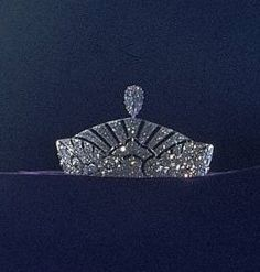 This art deco tiara belonged to the Marchioness of Angelsey, and is seen here at Christie's De Beers 'Ageless Diamonds' exhibition in 1950's. Her Majesty Elizabeth II donated her diamond Kokoshnik to be shown at the same exhibition, as did Helen, Duchess of Northumberland