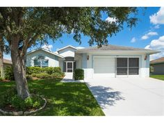 Tampa Bay Golf & Country Club is the PLACE to BE!  Live the Florida Lifestyle in this well maintained home located in a highly desirable Gated Resort Community. Screened front entry welcomes you to Great Room plan with sliders to enclosed, insulated Florida Room with Ceramic Tile floors, glass sliding windows, Air Conditioned with 2 ceiling fans and features a French Door to the Kitchen for easy access. Split bedroom plan with Master at the rear features tray ceiling, walk in closet, sliders…
