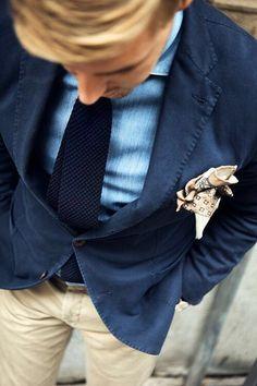 Navy blazer . Denim shirt . Navy knit tie . Camel / tan chinos . Camel / tan print pocket square