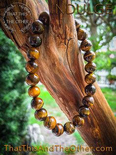 Beaded Tiger eye natural round stone beads bracelet and bangle. This semi-precious stone, stretchy, and about 19cm in length.  The natural brown beads can be worn by men or women.