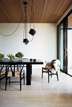 The black furniture works so well in the dining area because of the generous size of the room. Floor to ceiling windows add to a sense of openness. The timber ceiling and lighting arrangement draw the eye upward and create interest. Timber Ceiling, Wooden Ceilings, Wooden Ceiling Design, Wood Celing, Wood Ceiling Panels, Dark Ceiling, Ceiling Cladding, Ceiling Lighting, Decoration Inspiration