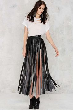 This skirt follows the 3:5 ratio because it's high-waisted. The length and use of vertical lines add height to the model.