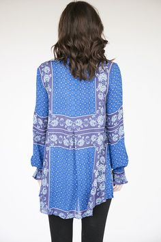 Details Free People exquisite true blue changing times tunic. This tunic fits impeccably on any body type. Collared V-neck with single button closer. Finished with elastic and ruffled cuff sleeves. Co