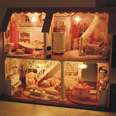 a small string of mini lights would work great for a lighted doll house! Homemade Dollhouse, Diy Dollhouse, Dollhouse Furniture, Romantic Gifts For Husband, Nifty Diy, Diy Cabin, Fairy Dolls, New Hobbies, Repurposed Furniture