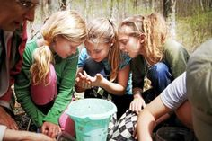 Young naturalists inspect organisms pulled from Kettle pond at the One World Conservation Center in Bennington.