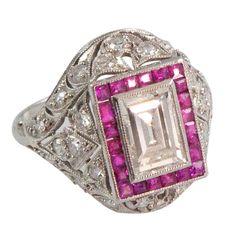 1stdibs   Art Deco Platinum, Diamond Emerald Cut & Ruby Ring 2.23 carats of diamonds, 1 carat center