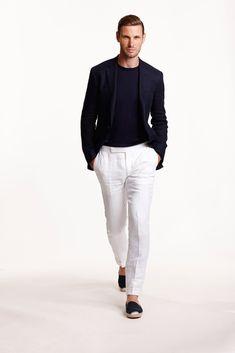 Shop this look on Lookastic:  http://lookastic.com/men/looks/navy-crew-neck-sweater-navy-blazer-white-dress-pants-black-espadrilles/9482  — Navy Crew-neck Sweater  — Navy Wool Blazer  — White Linen Dress Pants  — Black Canvas Espadrilles