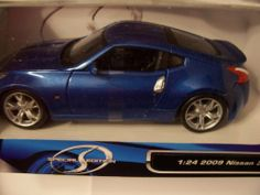 Maisto Special Edition 1:24 Scale Metallic Blue Nissan 370Z by Maisto. $19.99. Color: Metallic Blue . 2009 Nissan 370 . 1:24 Scale . Maisto Special Edition. Die-cast metal with plastic opening parts.. Maisto Special Edition 1:24 Scale Metallic Blue Nissan 370Z.  Die-cast metal with plastic opening parts.