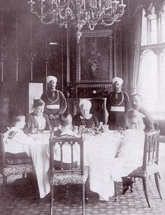 Queen Victoria dining at Windsor with her daughter Princess Beatrice, Beatrice's husband Henry of Battenburg, Princess Ena and two of the young princes (there were three: Alexander Albert, Leopold and Maurice).