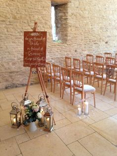 Ceremony styling at Kingscote Barn with silver lanterns, flowers & calligraphy sign. Hired & styled by www.littleweddinghelper.co.uk