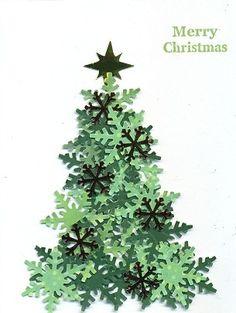 Troquela varios copos de nieve, únelos y crea un árbol de Navidad