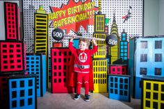 the superhero city backdrop for the photobooth I made. All painted cardboard boxes with black duct tape windows.