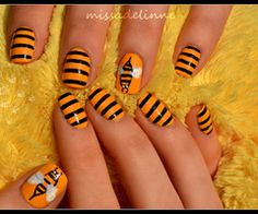 My daughter would love these bumble bee nails!