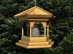 Build an easy bird feeder with free woodworking plans. The success of a bird feeder in attracting birds depends upon its placement and the kinds of seeds used. Large Bird Feeders, Wooden Bird Feeders, Bird Feeder Plans, Easy Bird, Build Your Own Shed, How To Attract Birds, Shed Plans, Woodworking Projects Plans, Garden Crafts