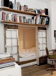 """Sleeping nook with reclaimed windows as doors."""" data-componentType=""""MODAL_PIN"""