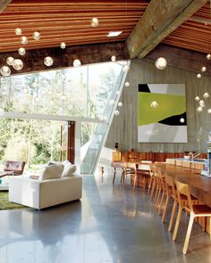 """Arbel's projects—both products and architectural commissions—follow a chronological numbering system. The house itself is his 23rd design, while the one-of-a-kind glass pendants that accent nearly every room like a starscape are called """"28."""""""