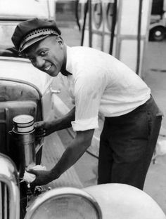Future 1936 Olympic Champion Jesse Owens working at a gas station in Cleveland Ohio, 1935.