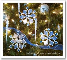 tutorial    http://www.holiday-crafts-and-creations.com/easy-to-make-christmas-ornaments.htmlI            f you have been looking for ideas for easy to make Christmas ornaments, these stained glue snowflakes are classy and yet very simple to make. When you are done, you will have elegant ornaments that will really give your home a wintry feel. You can hang them on the tree where they will glow, or you could hang them in your windows where they will really catch the light. This idea would even make a great kids Christmas craft with a little help from mom or dad.