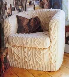 This knitted slip cover will help bring a touch of whimsy into your home.  Transform a boring chair into a cozy piece of knit decor using this handy slipcover.