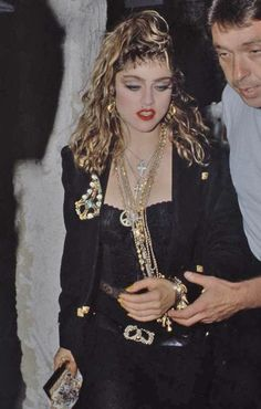 THIS LOOK REALLY WAS COOL BACK THEN, PROMISE!! PERHAPS HASN'T AGED AS WELL AS WE'D HAVE LIKED?  Madonna 1985