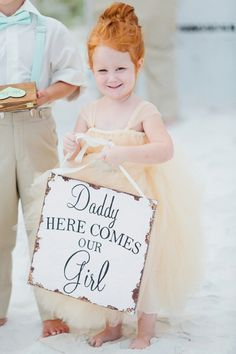 This sweet little flower girl - we just can't stop thinking she's the cutest!