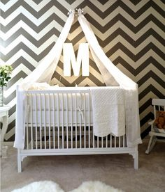 A DIY Canopied Crib: designer attached toilet paper roll hardware to the  wall and then tied the white canopy strings to it!