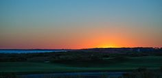 """Beautiful vibrant array of colors develops outside the Atlantic Room at the Ocean Course Clubhouse at Kiawah Island Golf Resort as the sunsets.  """"Sunset at the Ocean Course"""" © by Christy Cox - beauty of nature"""