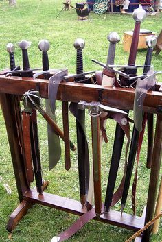 Prop weapons rack with unused polearms, etc attached Larp, Medieval Furniture, Weapon Storage, Medieval Weapons, Swords And Daggers, Gifts For Photographers, Dark Ages, Medieval Fantasy, Taking Pictures