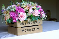 Crate of flowers on the ceremony table in the Saddlery by Karen at the Flower Mill