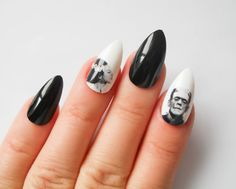 This set of stiletto nails feature Frankenstein and his bride. The rest of the nails match perfectly in a bold, deep black.    They are protected by a
