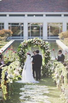 Love this gorgeous garden style ceremony arch!