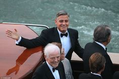 One happy man:The deed is done - George Clooney is a bachelor no more, having married stunning Amal Alamuddin in Venice