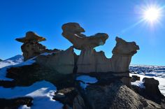 """Bisti / De-Na-Zin Wilderness, New Mexico.  The common name of this area is taken from the Navajo Bistahí, which means """"among the adobe formations."""" In addition to the hoodoos, petrified wood, and other rock features, there are petroglyphs — people have inhabited the region continuously for 12,000 years."""