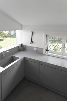 C House: Cucina in stile in stile Minimalista di EXiT architetti associati
