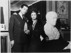 Coco Chanel & Serge Lifar next to a Diaghilev bust.