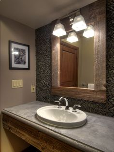 Bathroom River Rock Design, concrete countertop, repurposed wood
