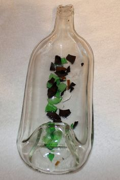 Glass bottle slumped with broken glass inside before melting