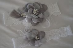 Shades of grey, each petal is hand cut, singed and sewn into place. Chiffons and Satins. Embellished free hand with pearls, rhinestones, crystals. Garters don't have to be boring they can me small inspirations. My garters are made inspires by my sashes, headpieces, fascinators, hair flower. What inspires YOU?