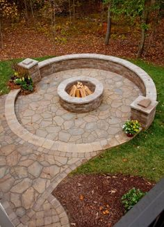 Low wall encircling fire pit for seating. As seen in Southern Living.
