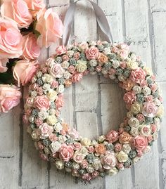 Custom made 12 (30cm) floral wreath which can be done in a colour scheme of your choice. I use a polystyrene wreath base and then cover with individual roses in various sizes and shades. Can come as it is or with ribbon attached (also in a colour of your choice) to hang. These make